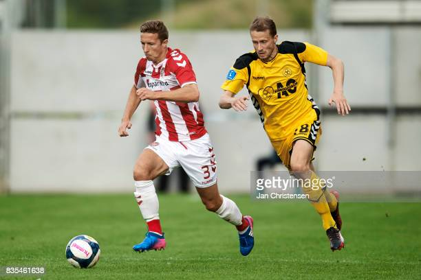 Jakob Ahlmann of AaB Aalborg and Jeppe Mehl of AC Horsens in action during the Danish Alka Superliga match between AC Horsens and AaB Aalborg at Casa...