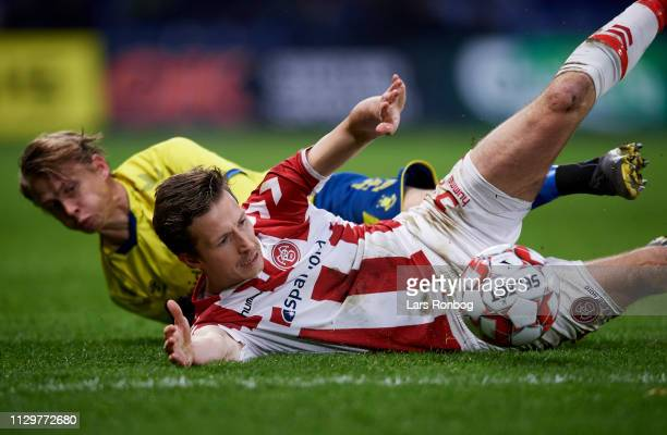 Jakob Ahlmann of AaB Aalborg and Simon Hedlund of Brondby IF compete for the ball during the Danish Superliga match between Brondby IF and AaB...
