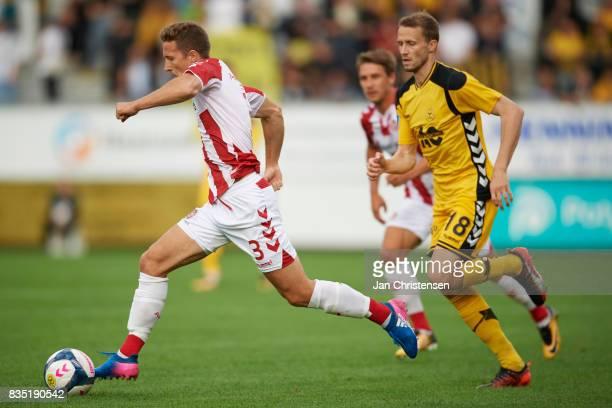 Jakob Ahlmann of AaB Aalborg controls the ball during the Danish Alka Superliga match between AC Horsens and AaB Aalborg at Casa Arena Horsens on...