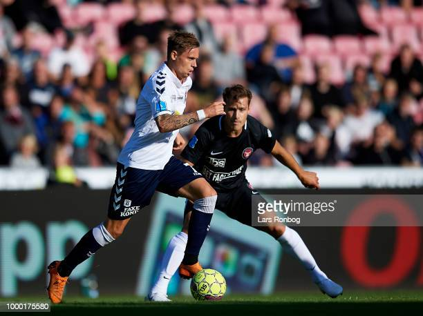 Jakob Ankersen of AGF Aarhus and Erik Sviatchenko of FC Midtjylland compete for the ball during the Danish Superliga match between FC Midtjylland and...