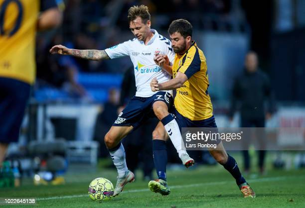 Jakob Ankersen of AGF Aarhus and Martin Mikkelsen of Hobro IK compete for the ball during the Danish Superliga match between Hobro IK and AGF Aarhus...