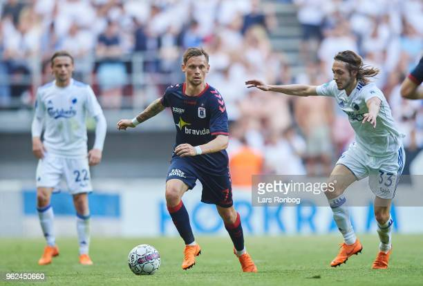 Jakob Ankersen of AGF Aarhus and Rasmus Falk of FC Copenhagen compete for the ball during the Danish Alka Superliga Europa League Playoff match...