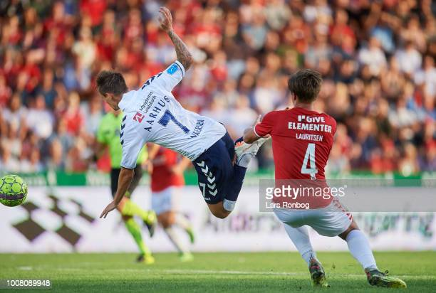 Jakob Ankersen of AGF Aarhus and Rasmus Lauritsen of Vejle Boldklub compete for the ball during the Danish Superliga match between Vejle Boldklub and...