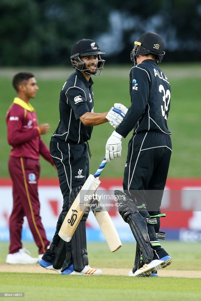Jakob Bhula of New Zealand celebrates his half century with teammate Finn Allen during the ICC U19 Cricket World Cup match between New Zealand and the West Indies at Bay Oval on January 13, 2018 in Tauranga, New Zealand.