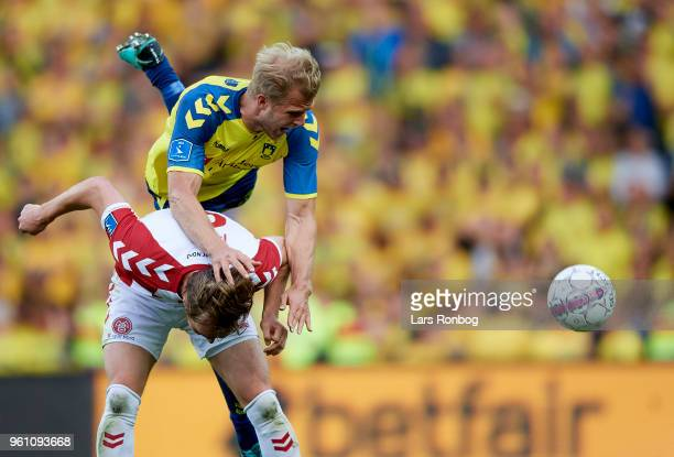 Jakob Blabjerg of AaB Aalborg and Paulus Arajuuri of Brondby IF compete for the ball during the Danish Alka Superliga match between Brondby IF and...