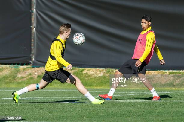 Jakob Bruun Larsen of Borussia Dortmund and Achraf Hakimi of Borussia Dortmund battle for the ball during a training session as part of the Borussia...