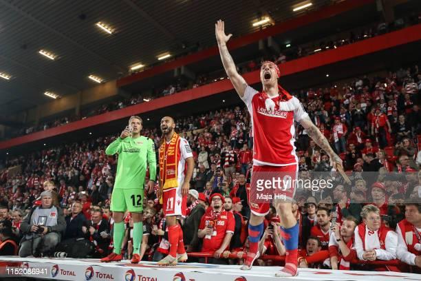 Jakob Busk of 1FC Union Berlin Akaki Gogia of 1FC Union Berlin and Sebastian Polter of 1FC Union Berlin celebrate after the Bundesliga playoff second...