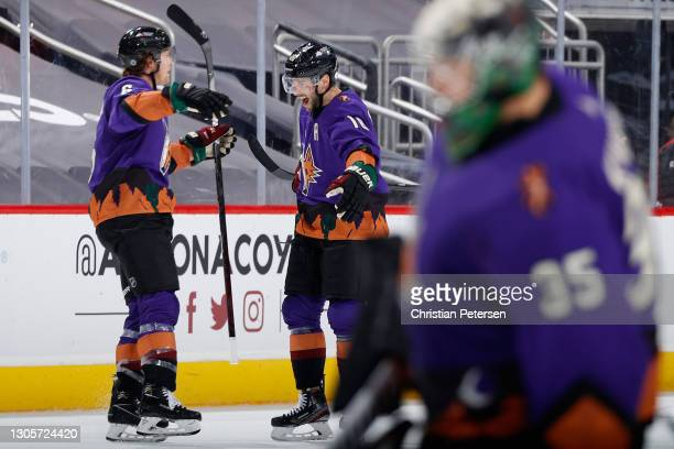 Jakob Chychrun and Derick Brassard of the Arizona Coyotes celebrate after Chychrun scored a goal against the Minnesota Wild during the second period...