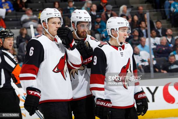 Jakob Chychrun, Brendan Perlini and Clayton Keller of the Arizona Coyotes face the San Jose Sharks at SAP Center on February 13, 2018 in San Jose,...