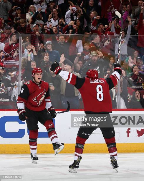 Jakob Chychrun of the Arizona Coyotes celebrates with Nick Schmaltz after scoring a power play goal against the Minnesota Wild during the third...