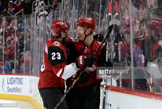 Jakob Chychrun of the Arizona Coyotes celebrates with teammate Oliver EkmanLarsson following his second period goal against the St Louis Blues at...