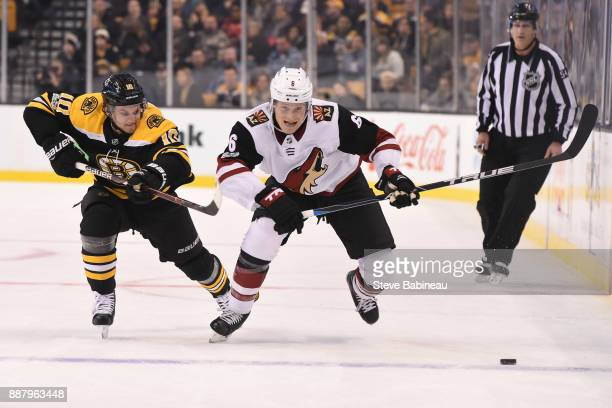 Jakob Chychrun of the Arizona Coyotes skates against Anders Bjork of the Boston Bruins at the TD Garden on December 7 2017 in Boston Massachusetts
