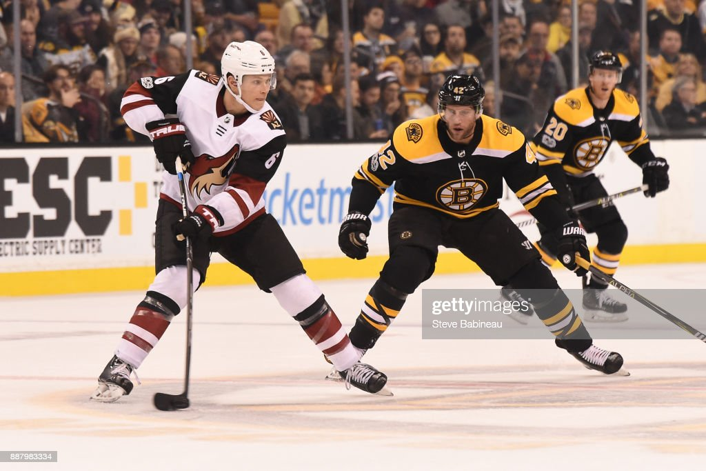 Jakob Chychrun #6 of the Arizona Coyotes skates against David Backes #42 of the Boston Bruins at the TD Garden on December 7, 2017 in Boston, Massachusetts.