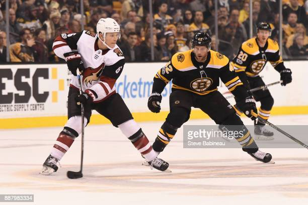 Jakob Chychrun of the Arizona Coyotes skates against David Backes of the Boston Bruins at the TD Garden on December 7 2017 in Boston Massachusetts