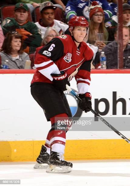 Jakob Chychrun of the Arizona Coyotes skates the puck up ice against the Vancouver Canucks net at Gila River Arena on April 6 2017 in Glendale Arizona