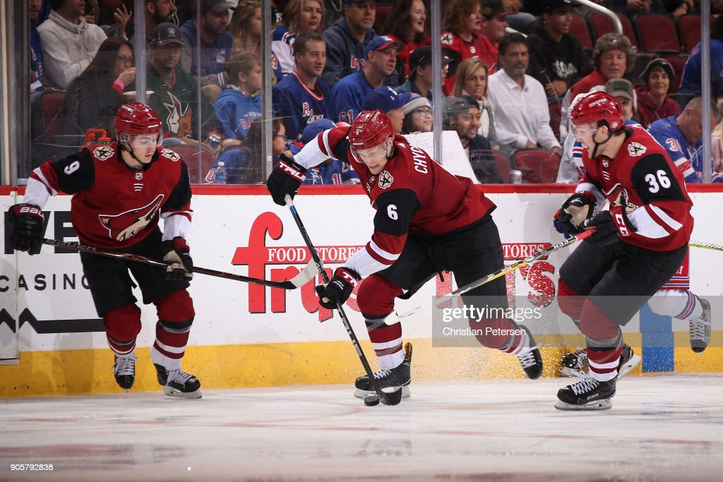 Jakob Chychrun #6 of the Arizona Coyotes skates with the puck between Clayton Keller #9 and Christian Fischer #36 during the NHL game against the New York Rangers at Gila River Arena on January 6, 2018 in Glendale, Arizona. The Rangers defeated the Coyotes 2-1 in an overtime shootout.