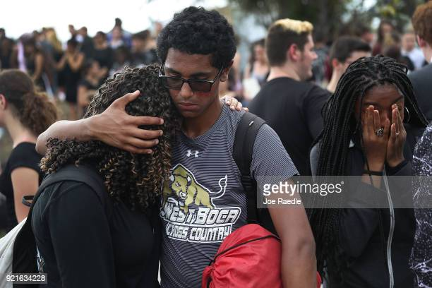 Jakob Desouza hugs Ruth Williams as the two West Boca High School students joined hundreds of fellow students that walked to Marjory Stoneman Douglas...