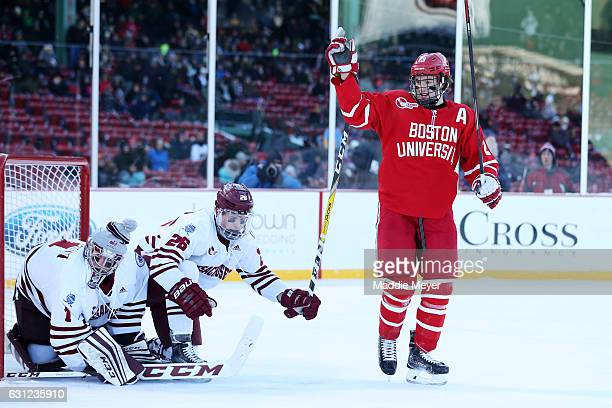 Jakob Forsbacka Karlsson of the Boston University Terriers celebrates after scoring against Ryan Wischow of the Massachusetts Minutemen during their...