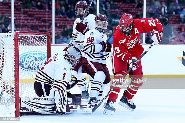 Jakob Forsbacka Karlsson of the Boston University Terriers scores against Ryan Wischow of the Massachusetts Minutemen with pressure from Joseph...