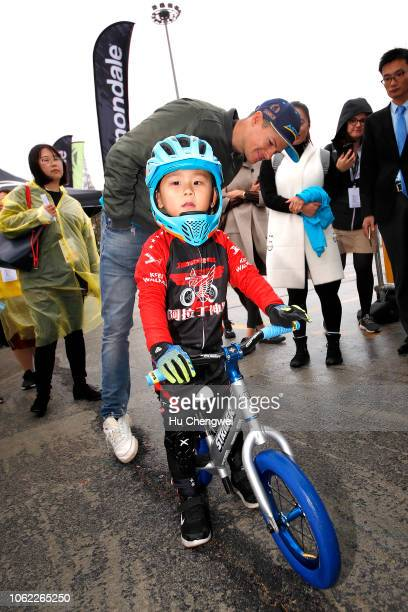 Jakob Fuglsang of Denmark and Astana Pro Team / Children / Fans / during visit the village and the Sports School in the 2nd Tour de France Shanghai...