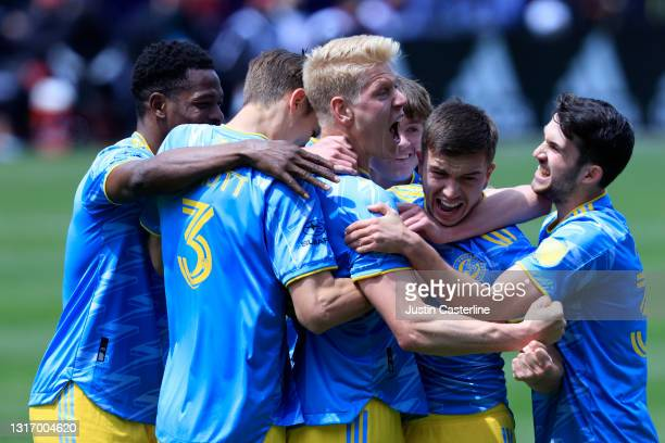 Jakob Glesnes of the Philadelphia Union celebrates with his team after a goal in the second half against the Chicago Fire at Soldier Field on May 08,...