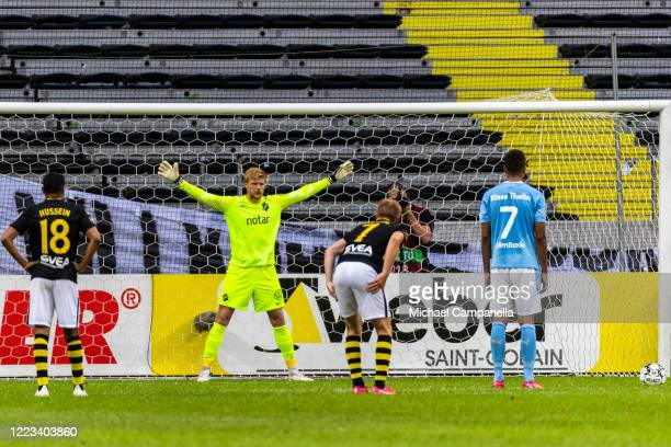 Jakob Haugaard goalkeeper for AIK prepares to defend a penalty shot from Isaac Kiese Thelin of Malmo FF during an Allsvenskan match between AIK and...