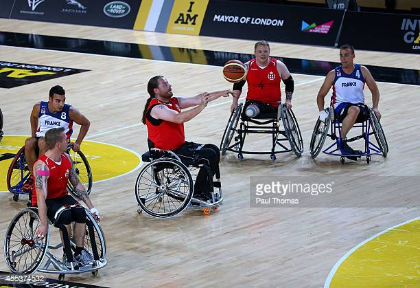 Jakob Hou Larsen of Denmark passes the ball during the Wheelchair Basketball bronze medal match between Denmark and France at the Copper Box Arena...