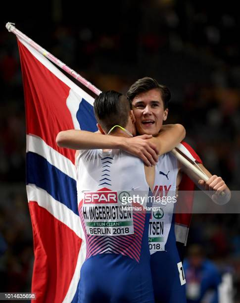 Jakob Ingebrigsten of Norway celebrates winning Gold with Henrik Ingebrigsten of Norway after the Men's 1500m Final during day four of the 24th...
