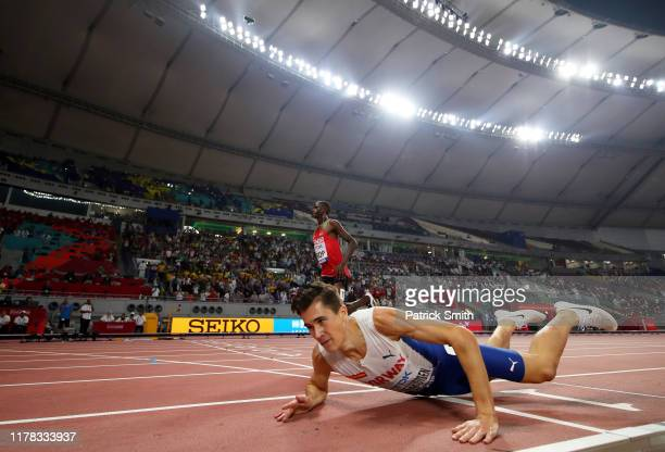 Jakob Ingebrigtsen of Norway falls across the finish line in the Men's 5000 metres final during day four of 17th IAAF World Athletics Championships...
