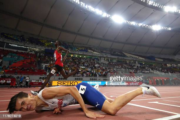 Jakob Ingebrigtsen of Norway falls to the track as he finishes in the in the Men's 5000 metres final during day four of 17th IAAF World Athletics...