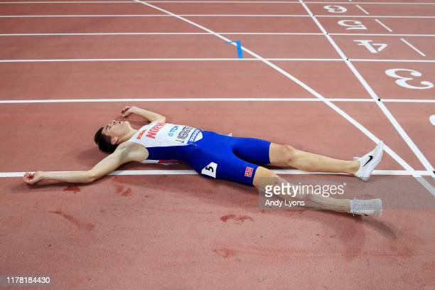 Jakob Ingebrigtsen of Norway lies on the track after crossing the finish line in the Men's 5000 metres final during day four of 17th IAAF World...
