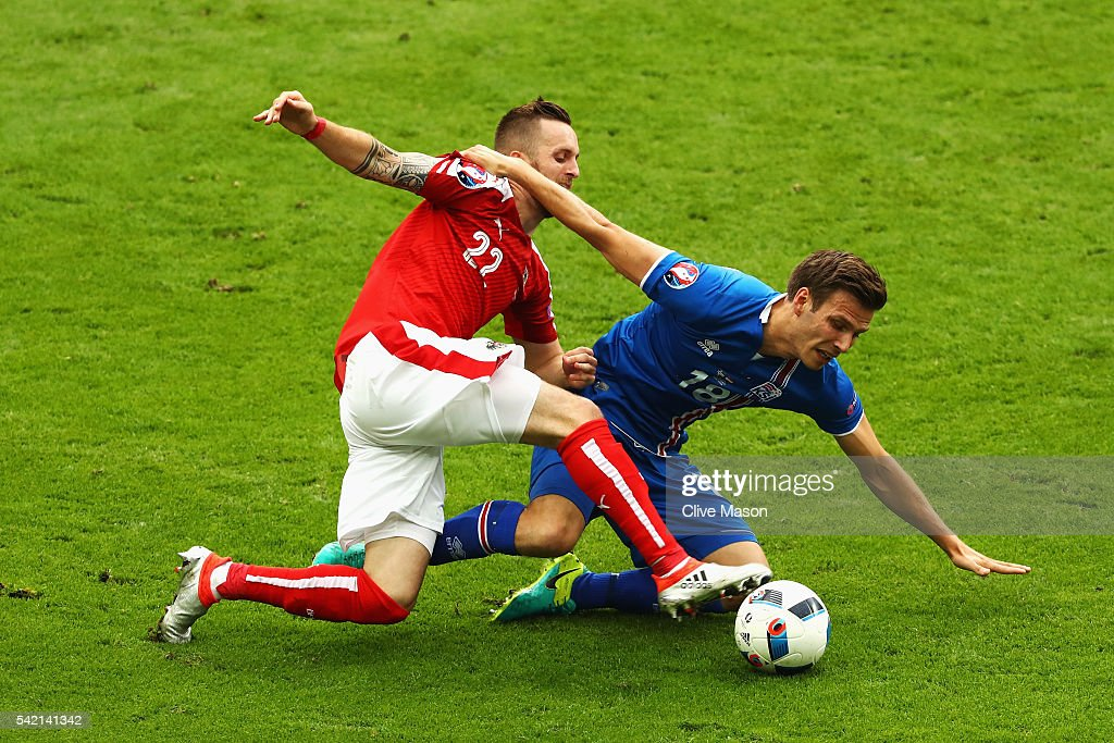 Jakob Jantscher of Austria and Elmar Bjarnason of Iceland challenge for the ball during the UEFA EURO 2016 Group F match between Iceland and Austria at Stade de France on June 22, 2016 in Paris, France.
