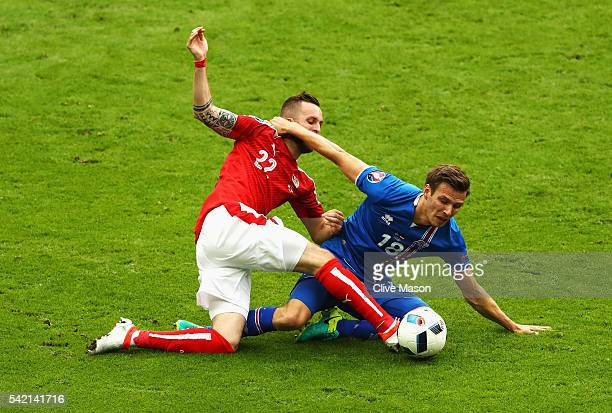 Jakob Jantscher of Austria and Elmar Bjarnason of Iceland challenge for the ball during the UEFA EURO 2016 Group F match between Iceland and Austria...