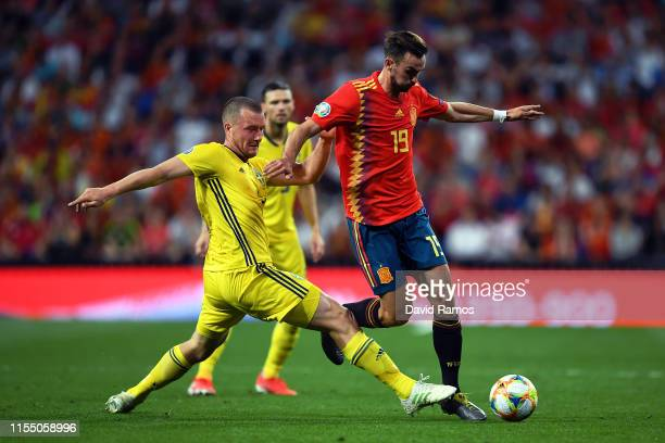 Jakob Johansson of Sweden tackles Fabian Ruiz of Spain during the 2020 UEFA European Championships group F match between Spain and Sweden at Bernabeu...
