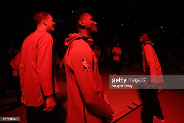 Jakob Poeltl Alfonzo McKinnie and Pascal Siakam of the Toronto Raptors during player introductions prior to the first half of an NBA game against the...