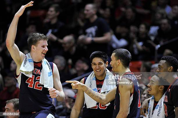Jakob Poeltl Chris Reyes Brekkott Chapman Brandon Taylor and Dakarai Tucker of the Utah Utes have fun on the bench during the latter stages of a 8341...