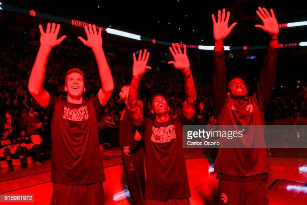 TORONTO ON FEBRUARY 8 Jakob Poeltl Delon Wright and Pascal Siakam of the Raptors warm their hands from the pyrotechnics before the 1st half of NBA...