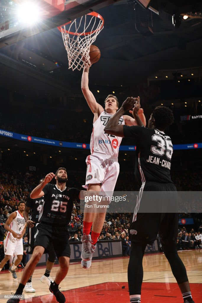 Jakob Poeltl #42 of the Raptors 905 goes up for the jam over Livio Jean-Charles #35 of the Austin Spurs at the Air Canada Centre on March 13, 2017 in Toronto, Ontario, Canada.