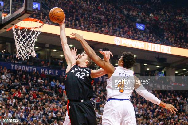 TORONTO ON FEBRUARY 8 Jakob Poeltl of the Raptors slams the ball during the 1st half of NBA action as the Toronto Raptors host the New York Knicks at...
