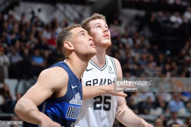 Jakob Poeltl of the San Antonio Spurs and Dwight Powell of the Dallas Mavericks jocks for a position during the game on April 10 2019 at the ATT...