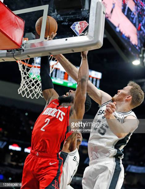 Jakob Poeltl of the San Antonio Spurs blocks shot of David Nwaba of the Houston Rockets in a pre-season game at AT&T Center on October 2, 2021 in San...