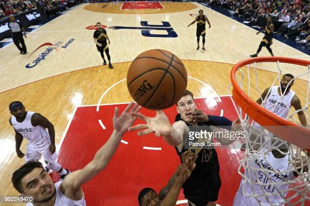 Jakob Poeltl of the Toronto Raptors battles for a rebound against the Washington Wizards during Game Six of Round One of the 2018 NBA Playoffs at...