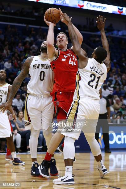 Jakob Poeltl of the Toronto Raptors drives against Darius Miller of the New Orleans Pelicans during the second half of a game at the Smoothie King...