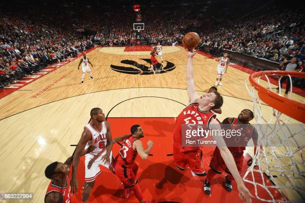 Jakob Poeltl of the Toronto Raptors drives to the basket during the game against the Chicago Bulls on October 19 2017 at the Air Canada Centre in...