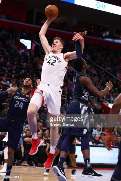 Jakob Poeltl of the Toronto Raptors drives to the basket past Reggie Jackson of the Detroit Pistons during the second half at Little Caesars Arena on...