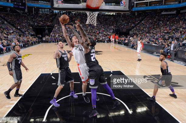 Jakob Poeltl of the Toronto Raptors goes up for the shot against JaKarr Sampson of the Sacramento Kings on December 10 2017 at Golden 1 Center in...