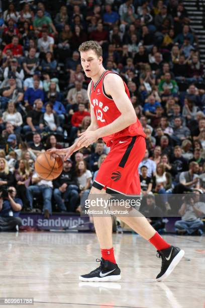 Jakob Poeltl of the Toronto Raptors handles the ball against the Utah Jazz on November 3 2017 at Vivint Smart Home Arena in Salt Lake City Utah NOTE...