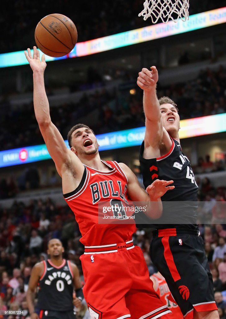 Jakob Poeltl #42 of the Toronto Raptors knocks the ball away from Zach LaVine #8 of the Chicago Bulls at the United Center on February 14, 2018 in Chicago, Illinois. The Raptors defeated the Bulls 122-98.