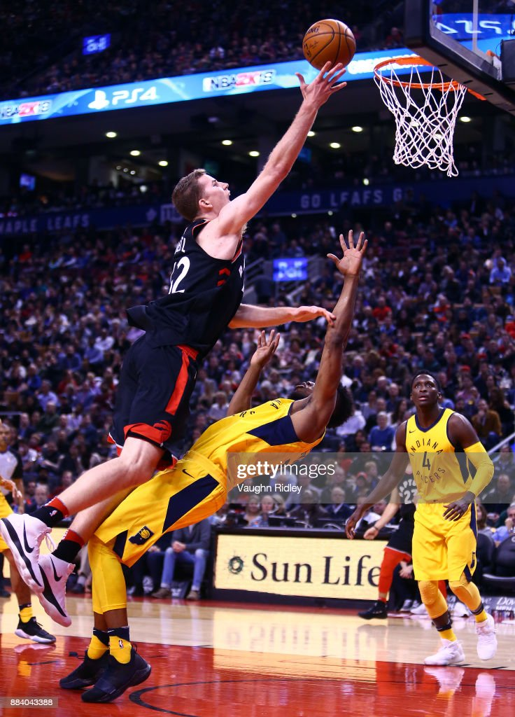 Jakob Poeltl #42 of the Toronto Raptors shoots the ball as Thaddeus Young #21 of the Indiana Pacers defends during the second half of an NBA game at Air Canada Centre on December 1, 2017 in Toronto, Canada.