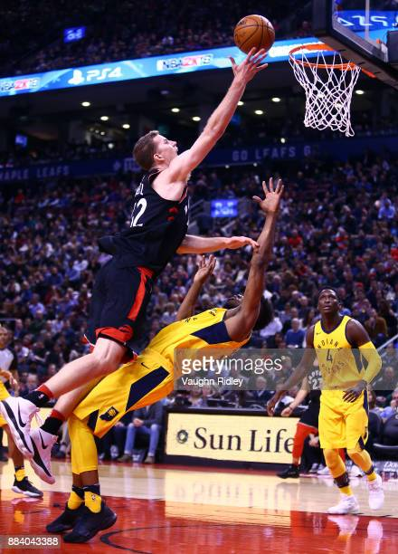 Jakob Poeltl of the Toronto Raptors shoots the ball as Thaddeus Young of the Indiana Pacers defends during the second half of an NBA game at Air...